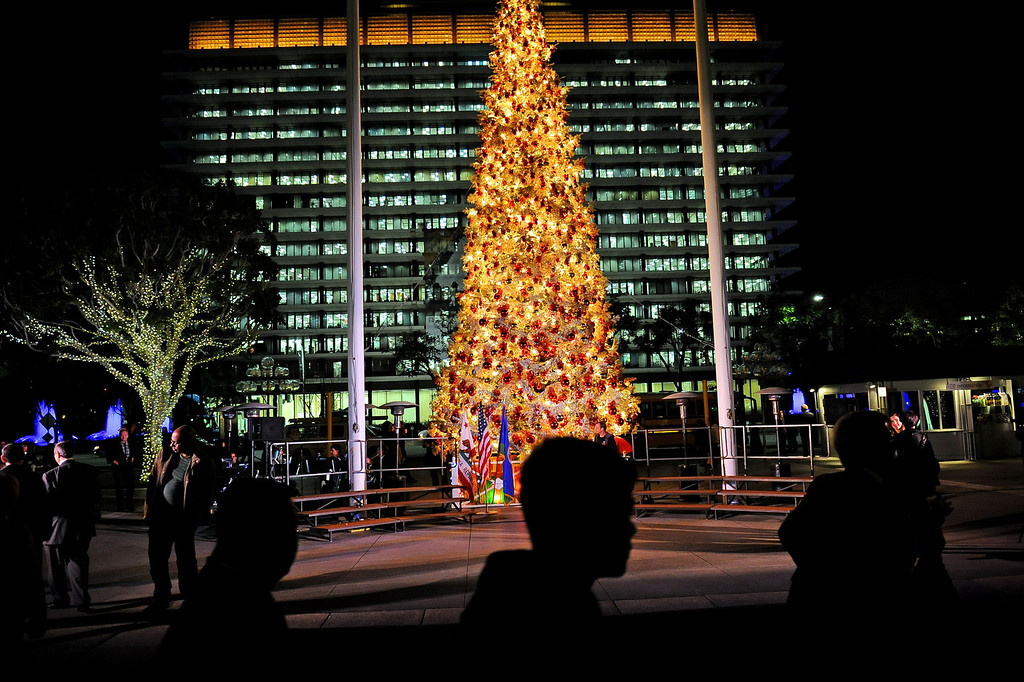 . Visitors pass by the Los Angeles County Christmas Tree following the annual lighting ceremony December 2 , 2013 in Los Angeles, CA.  The 50-foot tree is located in front of the  Los Angeles County Music Center in downtown Los Angeles.(Photo by Andy Holzman/Los Angeles Daily News)