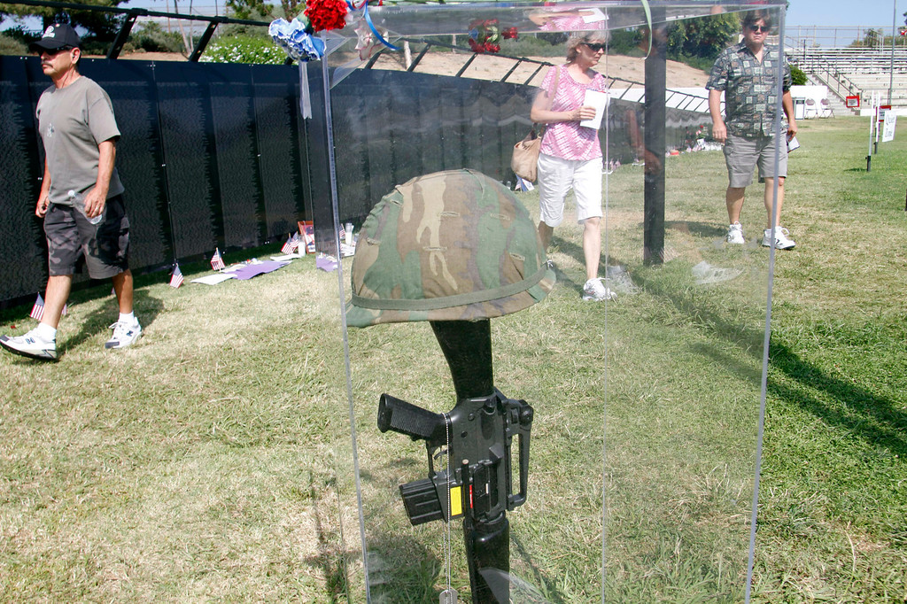 ". Guests get a last chance to view the Vietnam Veterans Memorial, during the Vietnam Veterans Memorial ""The Wall That Heals\"" Closing Ceremony event, at La Habra High School, in La Habra, Sunday, July 14, 2013. (SGVN/Correspondent Photo by James Carbone)"
