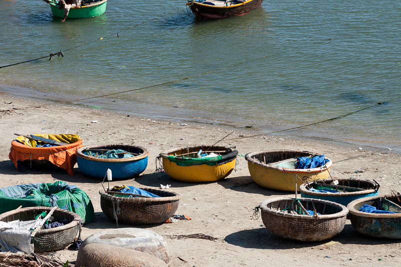 We watched them paddle these odd little soup bowl boats out in the ocean - it looked like a ton of hard work, and we wondered what their shape's purpose was.