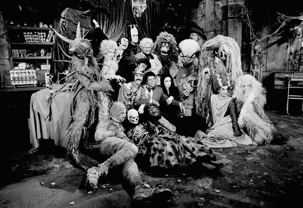 . Just about every horror monster ever invented for the movie industry was assembled by Sonny Bono and Cher and their guest star, Jerry Lewis, center, for the taping of their television show to be aired by CBS on Halloween, Friday, Oct. 4, 1973, Los Angeles, Calif. In the group, among others, are Frankensteins monster, Dracula, the Mad Scientist, Wolfman, Sea Monster, Cyclops, Bat Girl, and Bride of Frankenstein. (AP Photo/David F. Smith)
