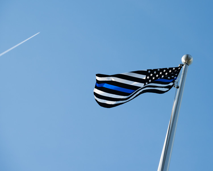 Flag for fallen officers flying high.jpg