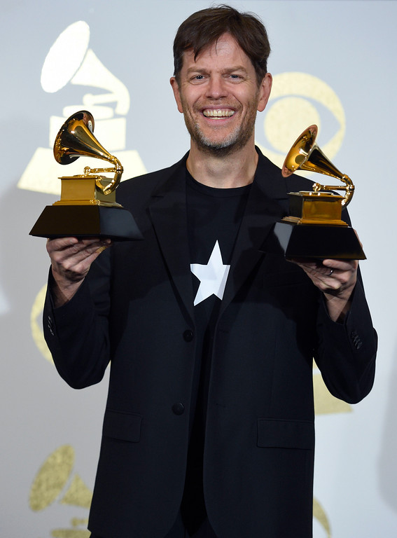 . Donny McCaslin poses in the press room with the awards for at the 59th annual Grammy Awards at the Staples Center on Sunday, Feb. 12, 2017, in Los Angeles. (Photo by Chris Pizzello/Invision/AP)