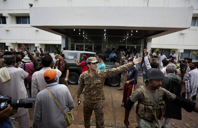 . Pakistani troops call on protesters to evacuate the state television building in Islamabad, Pakistan on Monday, Sept. 1, 2014. Anti-government protesters and Pakistani police have clashed once again as the demonstrators pushed into a sprawling government complex in the country\'s capital in an effort to try to reach the prime minister\'s official residence. (AP Photo/Anjum Naveed)