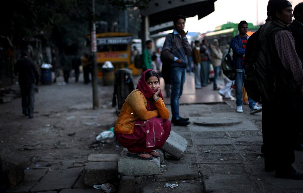 . An Indian woman watches a candlelight vigil outside the hospital, where the recent rape victim is being treated, in New Delhi, India, Thursday, Dec. 20, 2012. The hours-long gang-rape and near-fatal beating of a 23-year-old student on a bus in New Delhi triggered outrage and anger across the country as Indians demanded action from authorities who have long ignored persistent violence and harassment against women. (AP Photo/Altaf Qadri)