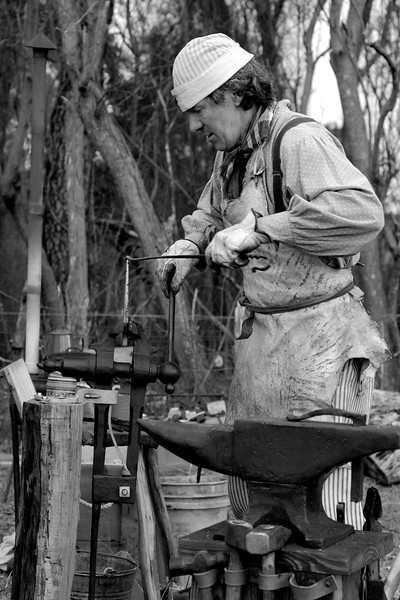 Joe Marsh demonstrates blacksmithing. The Skirmish at Gamble's Hotel happened on March 5, 1885 when 500 federal soldiers, under the command of Reuben Williams of the 12th Indiana Infantry, marched into Florence to destroy the railroad depot but were met by Confederate soldiers backed up with 400 militia. The reenactment, held by the 23rd South Carolina Infantry, was held at the Rankin Plantation in Florence, South Carolina on Saturday, March 5, 2011. Photo Copyright 2011 Jason Barnette