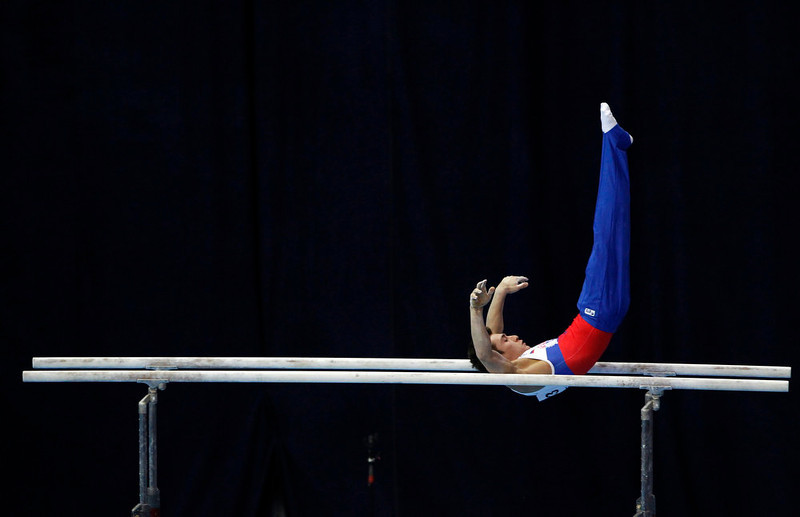 . David Belyavskiy of Russia competes on the parallel bars during the men\'s all-around final at the European Men\'s and Women\'s Artistic Gymnastic individual Championships in Moscow April 19, 2013.  REUTERS/Maxim Shemetov