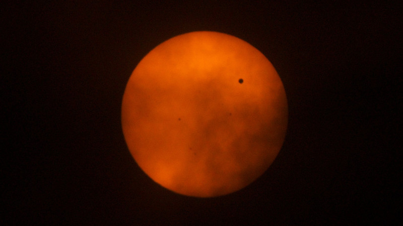 Venus passing between Earth and the Sun
