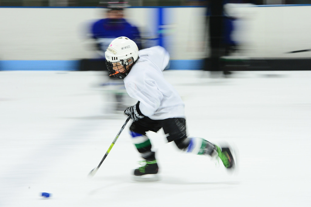 . First year hockey player Jonathan Compton, 7, skates down ice during a drill at Edge Ice Arena on February 17, 2016 in Littleton, Colorado. Hockey has developed a following in Colorado especially after the Colorado Avalanche moved into the state 20 years ago. The interest in hockey has begun to boom from three-year-olds to adults, either playing in recreation leagues or learning the game for the first time. The Foothill Flyers are one of those organizations seeing some of that trend with enrollment in their Under 8 league going from 50 children to 100 in three years. (Photo by Brent Lewis/The Denver Post)