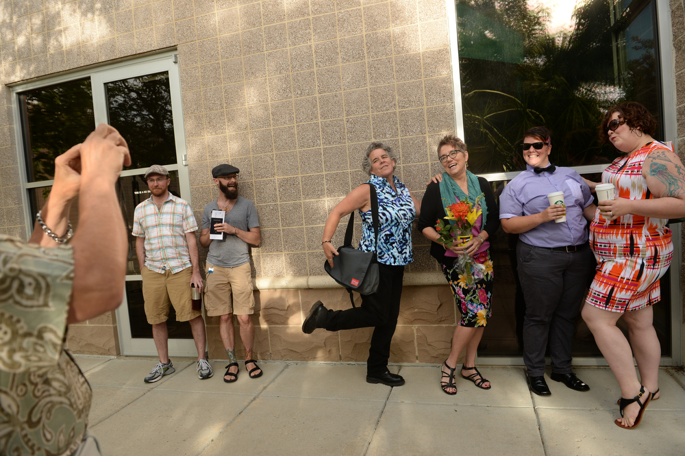 . Same-sex couples line up outside Boulder County Clerk\'s office to apply for marriage licenses, June 26, 2014. The state of Utah\'s same-sex marriage ban was struck down by the 10th Circuit Supreme Court. (Photo by RJ Sangosti/The Denver Post)