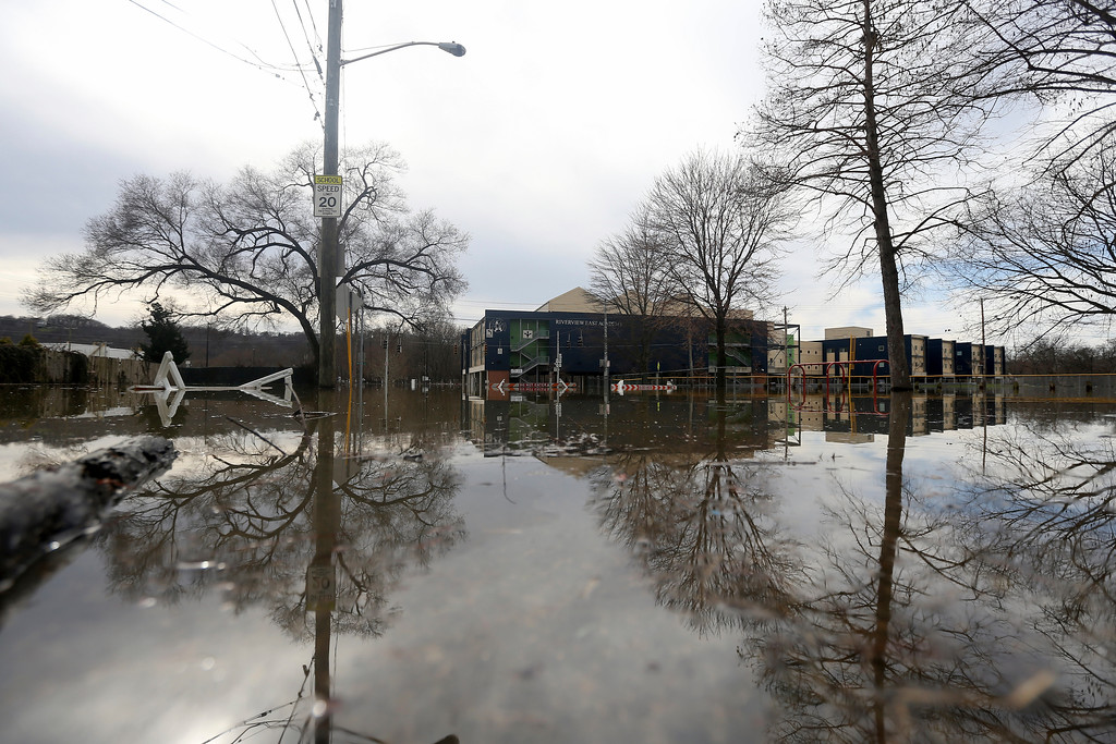 . Rising flood waters engulf Riverview East Academy along Kellogg Avenue in the East End, Sunday, Feb. 25, 2018. Heavy rains overnight have sent the swollen Ohio River to its highest point in 20 years with the river expected to remain above flood stage through the end of the week, a National Weather Service meteorologist said Sunday. (Kareem Elgazzar/The Cincinnati Enquirer via AP)