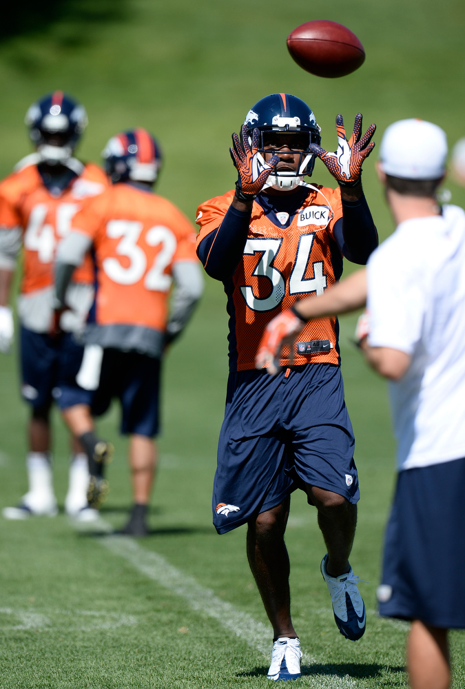 . Quentin Jammer (34) of the Denver Broncos catches a pass during OTAs June 6, 2013 at Dove Valley. (Photo By John Leyba/The Denver Post)