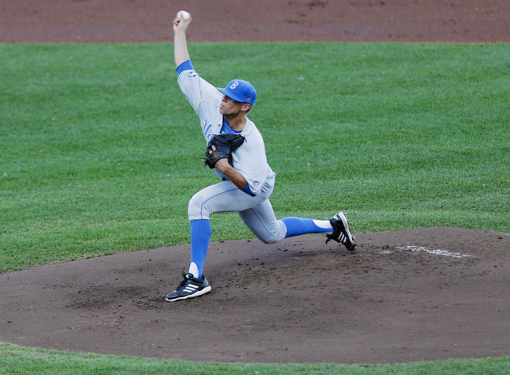 . UCLA starting pitcher Nick Vander Tuig delivers against North Carolina State in the first inning of an NCAA College World Series game in Omaha, Neb., Tuesday, June 18, 2013. (AP Photo/Nati Harnik)