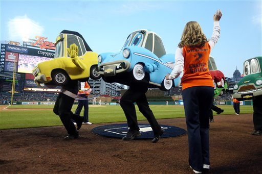 . The Motor City Wheels mascot races take place during the fourth inning of a baseball game between the Detroit Tigers and the New York Yankees, Tuesday, April 21, 2015, in Detroit. (AP Photo/Carlos Osorio)