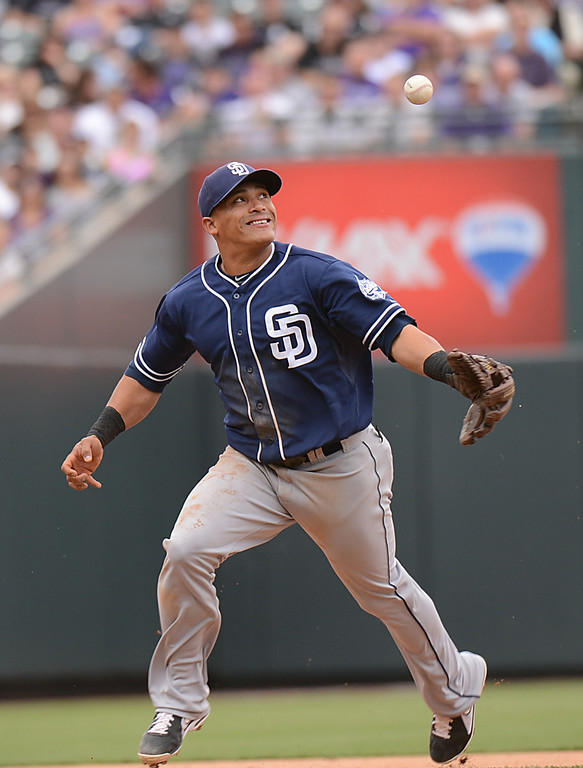 . Everth Cabrera (2) of the San Diego Padres bobbles a ball hit by Josh Rutledge (14) of the Colorado Rockies, allowing Rutledge to reach base.(Photo by Hyoung Chang/The Denver Post)