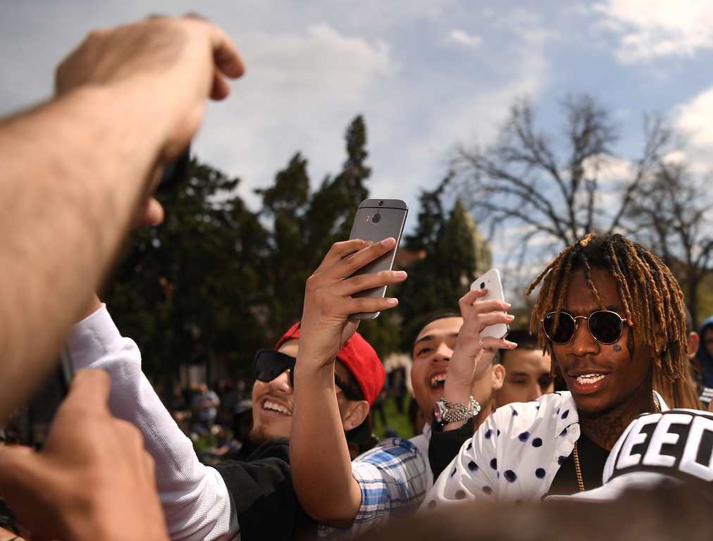. A look-alike of Rapper and songwriter, Wiz Khalifa is surrounded as he arrived at Civic Center Park in Denver, April 20, 2016. People gather at the park to celebrate the annual 420 day. (Photo by RJ Sangosti/The Denver Post)