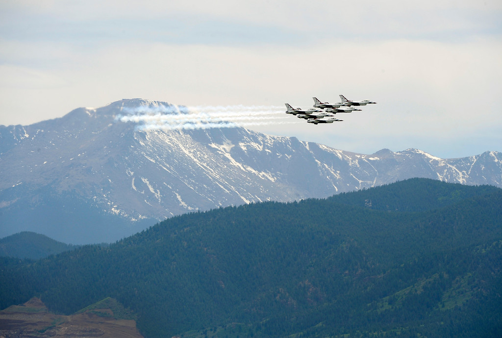 . The United States Air Force Thunderbirds fly past Pikes Peak during practice maneuvers in preparation for the 2012 United States Air Force Academy graduation featuring a commencement address from President Barack Obama. Andy Cross, The Denver Post