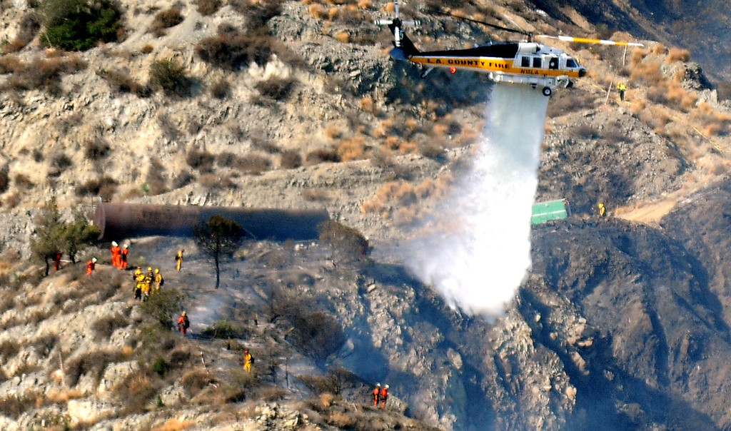 . Los Angeles County Firefirghters and camp crews with aid of water dropping helicopters battle a five acre brush fire in the San Gabriel Mountains above Azusa just above the former Shooting range on Tuesday, Aug. 27, 2013 in Azusa, Calif.   (Keith Birmingham/Pasadena Star-News)