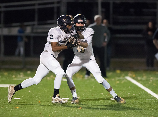 11/01/18 Wesley Bunnell | Staff Newington football vs Maloney at Falcon Field in Meriden on Thursday evening. QB Nicholas Pestrichello (6) hands off to Dylan Nees-Fair (3).