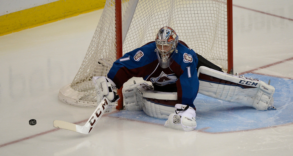 . DENVER, CO - FEBRUARY 18: Colorado Avalanche goalie Semyon Varlamov (1) pokes the puck away against the Los Angeles Kings February 18, 2015 at Pepsi Center. (Photo By John Leyba/The Denver Post)