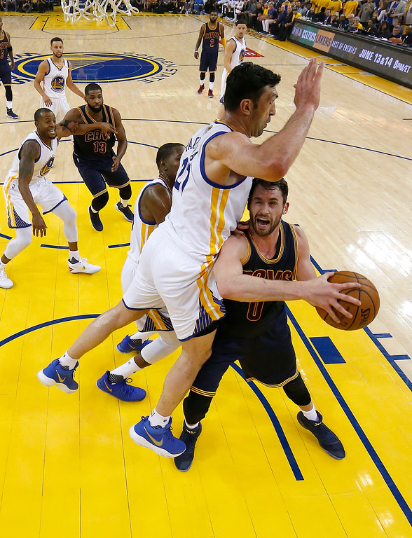 . Golden State Warriors center Zaza Pachulia (27), top, defends against Cleveland Cavaliers forward Kevin Love during the first half of Game 1 of basketball\'s NBA Finals in Oakland, Calif., Thursday, June 1, 2017. (AP Photo/Marcio Jose Sanchez, Pool)