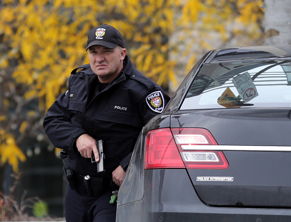 . A police officer stands guard on Wellington St. in downtown, October 22, 2014 in Ottawa, Canada. Officials are investigating multiple reports of shootings and suspects after at least one gunman shot a Canadian soldier and then entered Canada\'s Parliament building.   (Photo by Mike Carroccetto/Getty Images)