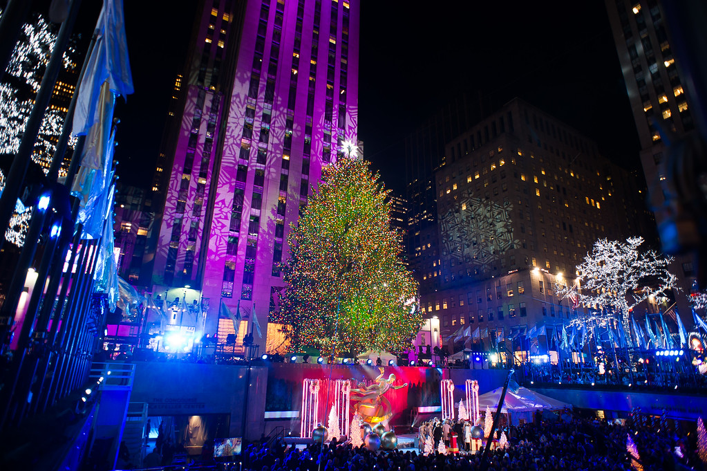 . FILE - In this Dec. 3, 2014 file photo, the Rockefeller Center Christmas tree is lit in New York. The 13-ton spruce\'s former home was outside a century-old farmhouse in Danville, Pa. (Photo by Charles Sykes/Invision/AP, File)
