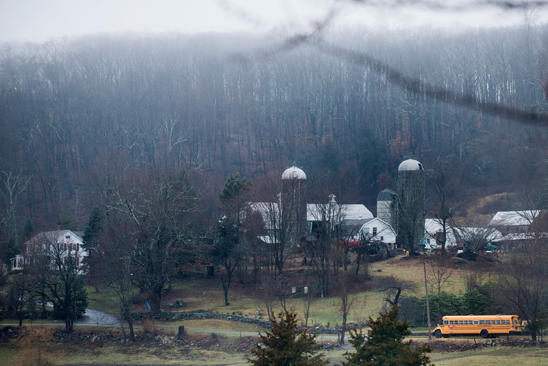 . A school bus drives past a farm while picking up students December 18, 2012 in Newtown, Connecticut. Students in Newtown, excluding Sandy Hook Elementary School, return to school for the first time since last Friday\'s shooting at Sandy Hook which took the live of 20 students and 6 adults.  BRENDAN SMIALOWSKI/AFP/Getty Images
