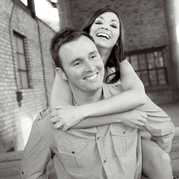 Couple during outdoor summer engagement session in the River District in downtown Rockford, IL