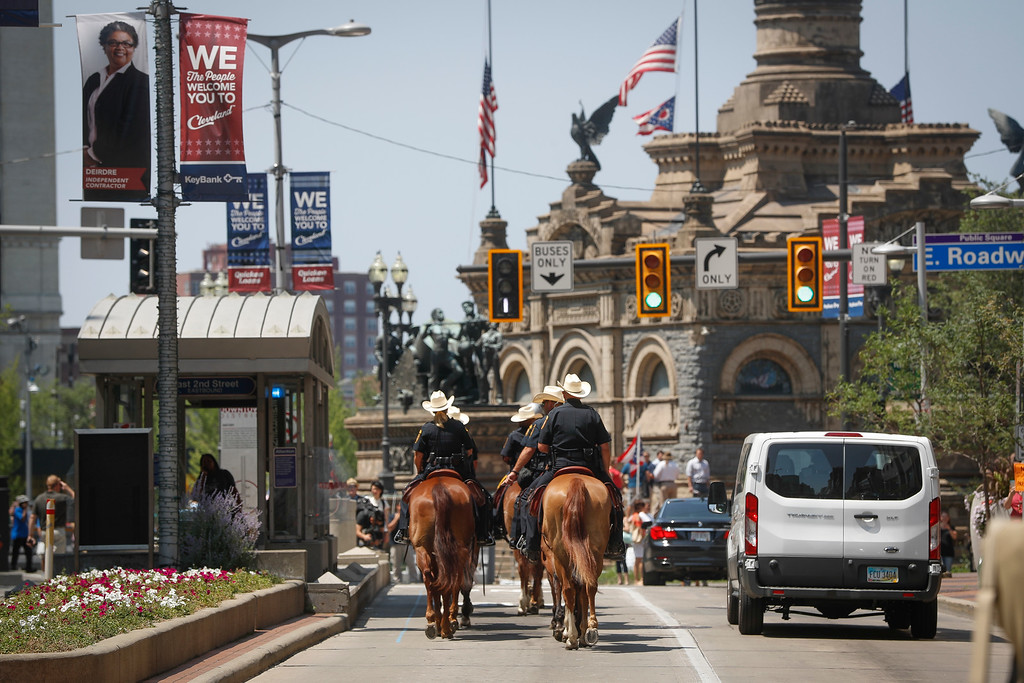 . Mounted police officers head towards Public Square on Tuesday, July 19, 2016, in Cleveland, during the second day of the Republican National Convention. (AP Photo/John Minchillo)