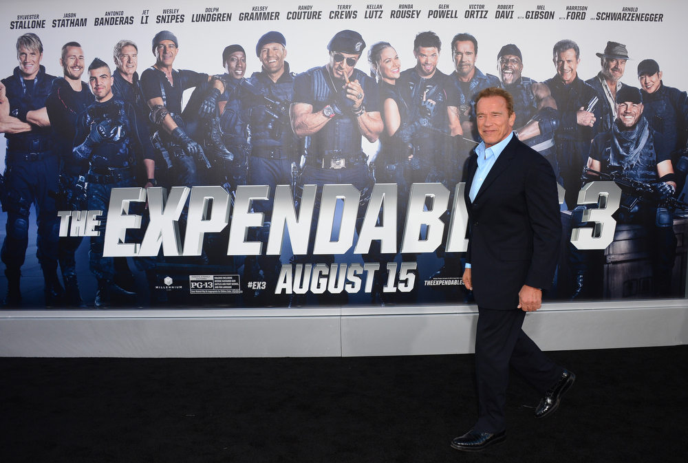 """. Arnold Schwarzenegger arrives at the premiere of \""""The Expendables 3\"""" at TCL Chinese Theatre on Monday, Aug. 11, 2014, in Los Angeles. (Photo by Jordan Strauss/Invision/AP)"""