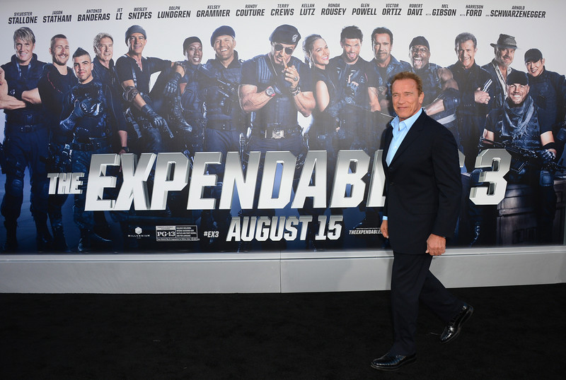 ". Arnold Schwarzenegger arrives at the premiere of ""The Expendables 3\"" at TCL Chinese Theatre on Monday, Aug. 11, 2014, in Los Angeles. (Photo by Jordan Strauss/Invision/AP)"