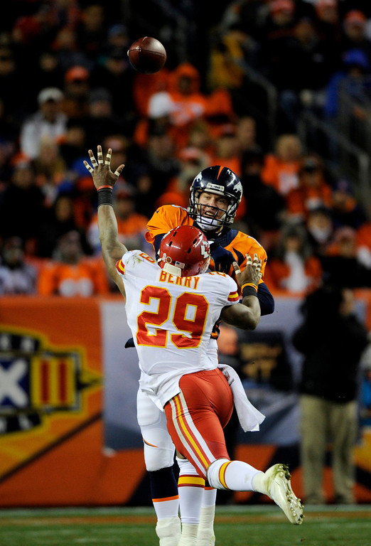 . Eric Berry of the Kansas City Chiefs jumps to block Peyton Manning\'s throw. The Denver Broncos take on the Kansas City Chiefs at Sports Authority Field on Nov. 17, 2013. (Photo By Erin Hull/The Denver Post)