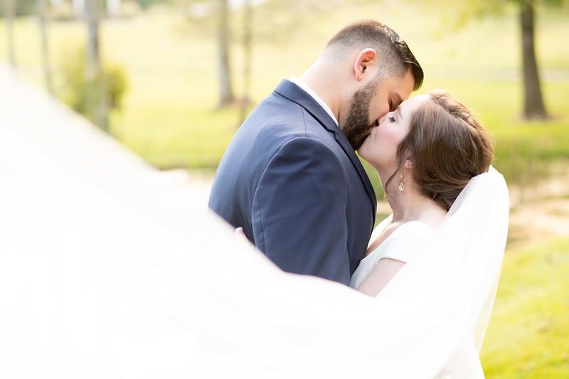 bride-groom-veil-kiss.jpg