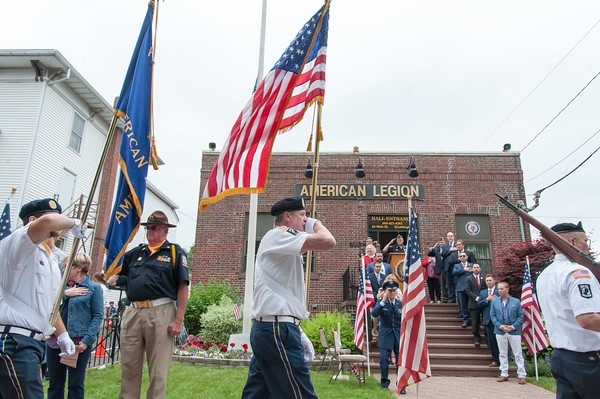 05/28/18 Wesley Bunnell   Staff A packed parade route greeted marchers in the 2018 Memorial Day Parade in Southington on Monday morning. Honor Guard members of American Legion Post 72 carry the flag in front of the post on Main St.