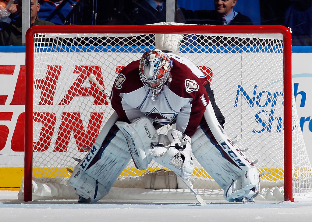 . UNIONDALE, NY - NOVEMBER 11: Semyon Varlamov #1 of the Colorado Avalanche looks down after allowing a sixth goal to the New York Islanders at the Nassau Veterans Memorial Coliseum on November 11, 2014 in Uniondale, New York. The Islanders shutout the Avalanche 6-0. (Photo by Bruce Bennett/Getty Images)