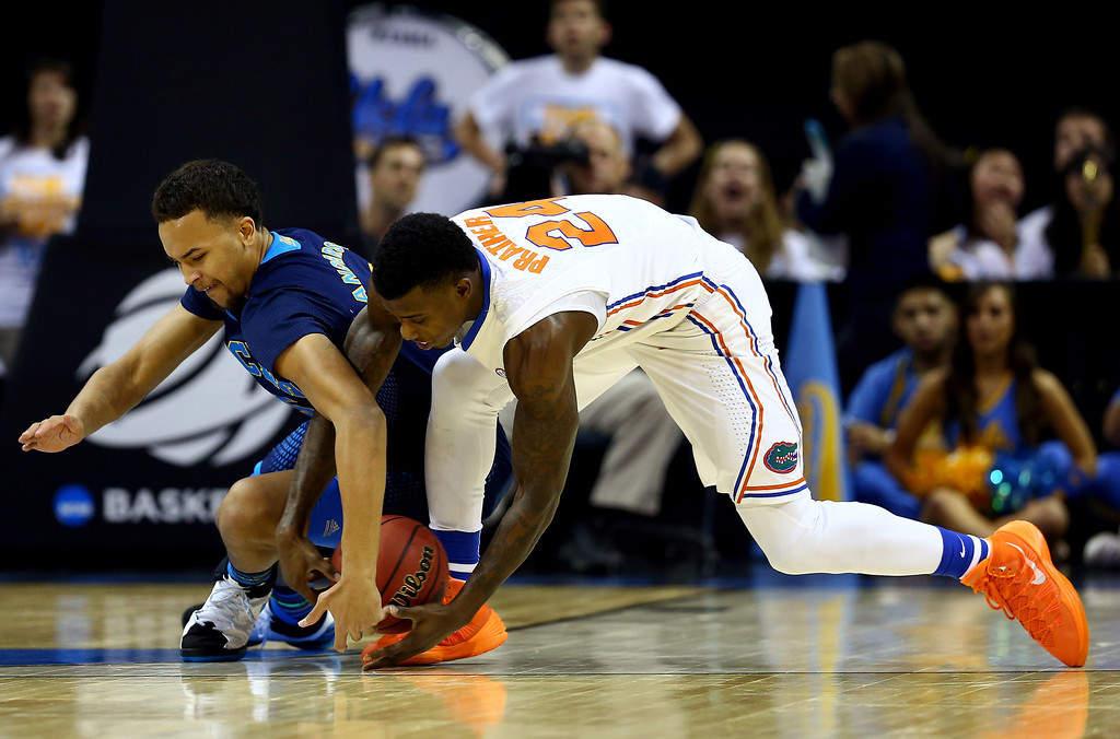 . Casey Prather #24 of the Florida Gators and Kyle Anderson #5 of the UCLA Bruins battle for a loose ball during a regional semifinal of the 2014 NCAA Men\'s Basketball Tournament at the FedExForum on March 27, 2014 in Memphis, Tennessee.  (Photo by Streeter Lecka/Getty Images)
