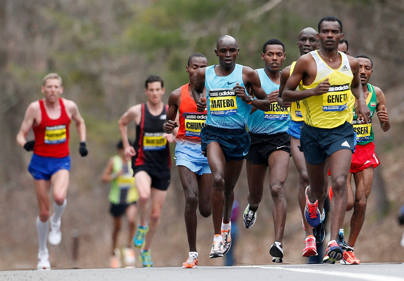. Elite mens marathoners including Levy Matebo, fourth from left, and Markos Geneti, front right, run in the 117th Boston Marathon in Wellesley, Mass., Monday, April 15, 2013. (AP Photo/Michael Dwyer)