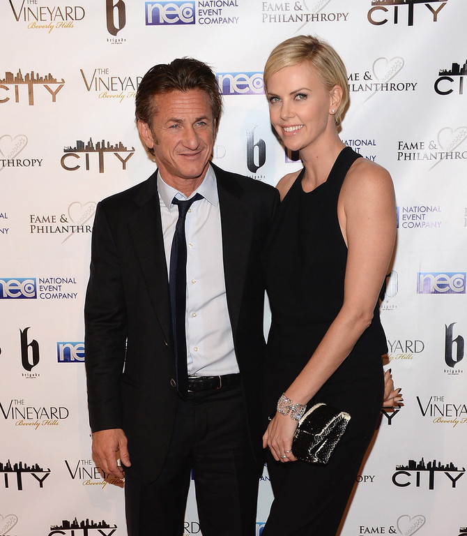 . Sean Penn and Charlize Theron attend the Fame and Philanthropy Post-Oscar Party at The Vineyard on March 2, 2014 in Beverly Hills, California.  (Photo by Jason Kempin/Getty Images)