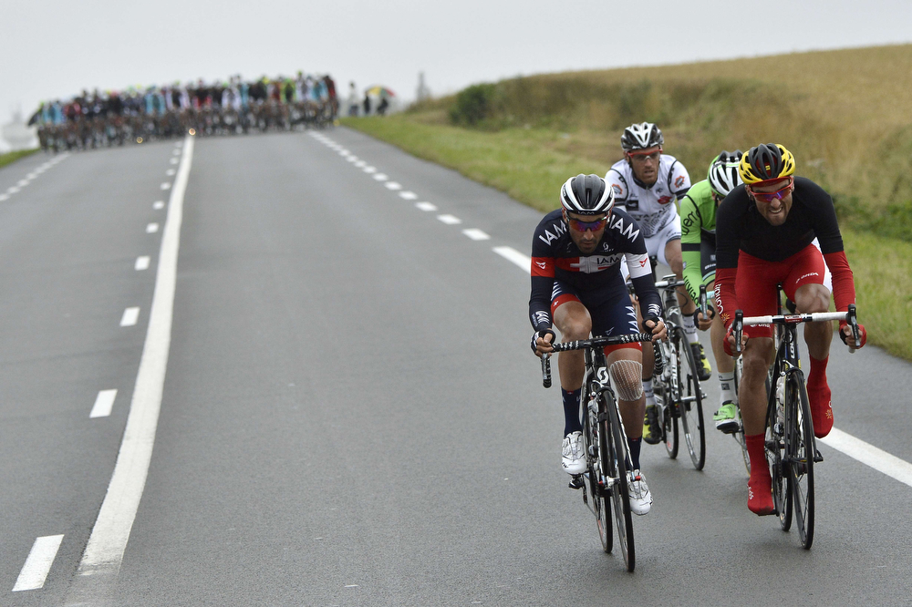 . (From L) France\'s Jerome Pineau, France\'s Arnaud Gerard, Netherlands\' Thomas Leezer and Spain\'s Luis Angel Mate Mardones ride in a breakaway during the 194 km sixth stage of the 101st edition of the Tour de France cycling race on July 10, 2014 between Arras and Reims, northern France.  (JEFF PACHOUD/AFP/Getty Images)