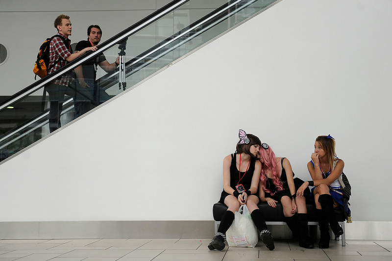 . Mira Smith, 16, left, as Miko from Vocaloid Juliet Watral, 16, Luka from Vocaloid, Courtney Molz, 16, as Lucy from Fairy Tale take a breather during Denver Comic Con at the Colorado Convention Center in Denver, Colorado on June 14, 2014. (Photo by Seth McConnell/The Denver Post)
