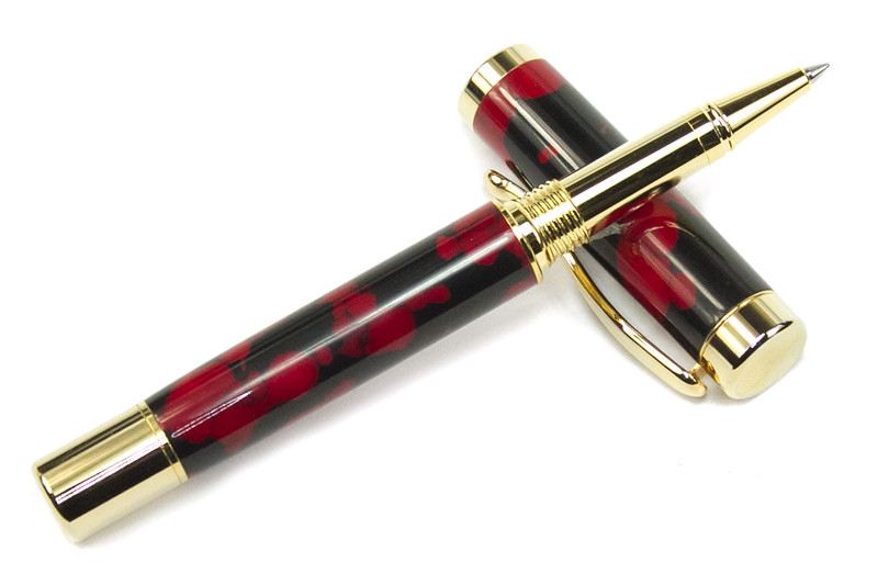 Atrax Gold Rollerball shown with Red and Black Trustone