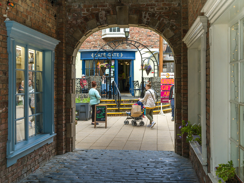 Tourists standing in front of caf� seen through an arch, Republic of Ireland
