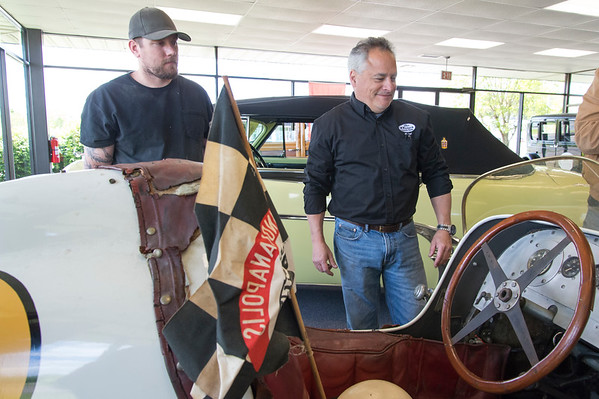 05/15/19 Wesley Bunnell | Staff Michael Donnelly, R, President of The Paddock Classic Car Restorations, looks over a custom built race car named the Marchese Special in his showroom located at 285 Columbus Boulevard. The race car which was built in the early 1940's competed in the Indianapolis 500 until 1951.