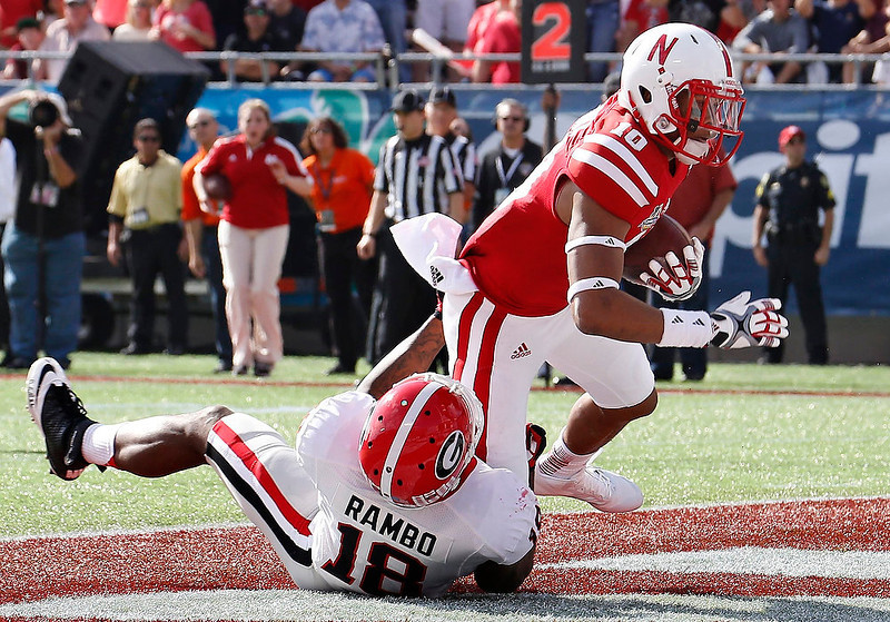 . Georgia Bulldogs safety Bacarri Rambo (18) fails to stop Nebraska Cornhuskers wide receiver Jamal Turner (10) from scoring during the Capital One Bowl in Orlando, Florida January 1, 2013. REUTERS/Pierre DuCharme
