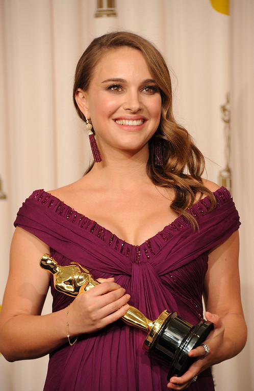 . Actress Natalie Portman, winner of the award for Best Actress in a Leading Role for \'Black Swan\', poses in the press room during the 83rd Annual Academy Awards held at the Kodak Theatre on February 27, 2011 in Hollywood, California.  (Photo by Jason Merritt/Getty Images)