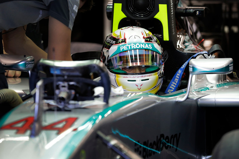 . Mercedes driver Lewis Hamilton of Britain prepares for the first practice session for the Singapore Formula One Grand Prix on the Marina Bay City Circuit in Singapore, Friday, Sept. 19, 2014. (AP Photo/Wong Maye-E)