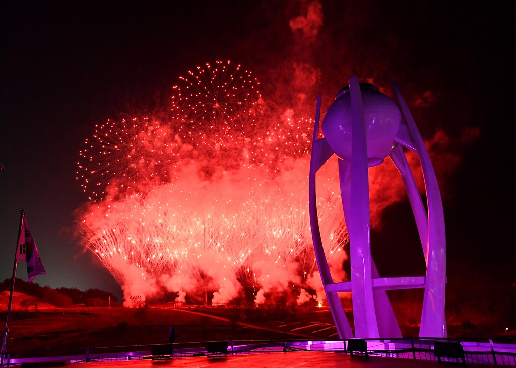 . Fireworks explode near the Olympic cauldron at the end of the closing ceremony of the 2018 Winter Olympics in Pyeongchang, South Korea, Sunday, Feb. 25, 2018. (Florien Choblet/Pool Photo via AP)