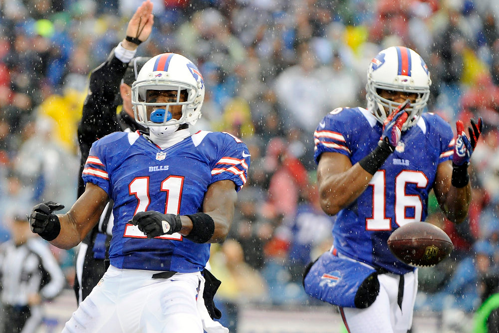 . Buffalo Bills wide receiver T.J. Graham (11) celebrates a catch with teammate Brad Smith (16) during the first half of an NFL football game against the Jacksonville Jaguars Sunday, Dec. 2, 2012 in Orchard Park, N.Y. (AP Photo/Gary Wiepert)