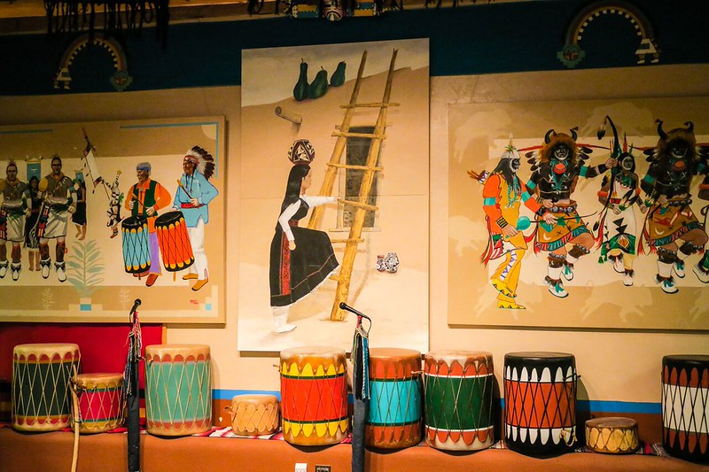 paintings of native dancers and colorful drums