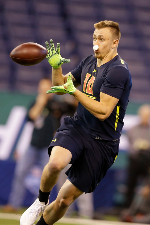 . Iowa tight end George Kittle runs a drill at the NFL football scouting combine in Indianapolis, Saturday, March 4, 2017. (AP Photo/Michael Conroy)